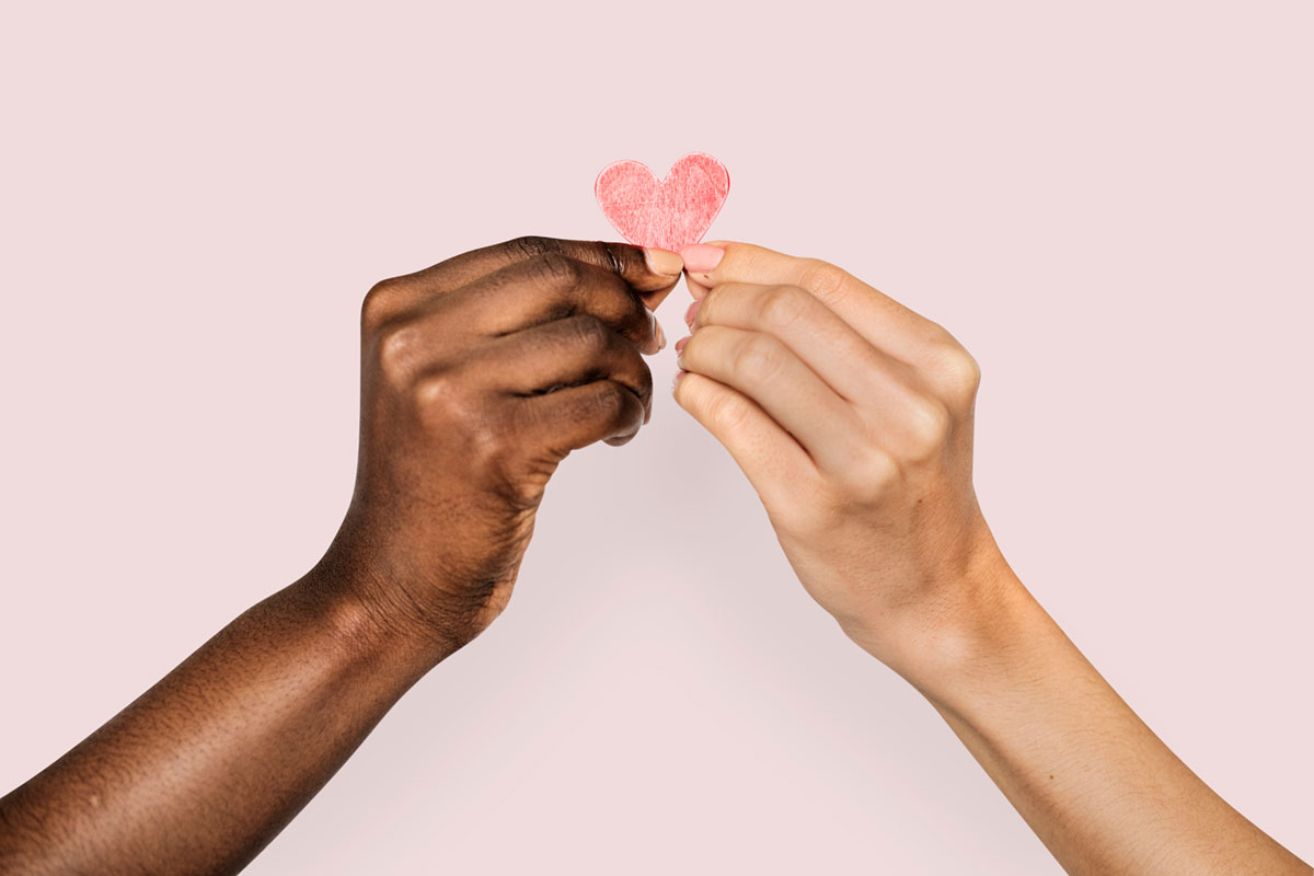 Two Hands Holding a Heart shape Symbolizing Charity